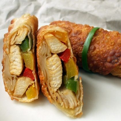 Could eat these all day long!       1 pound boneless, skinless chicken breasts, cut into thin strips      2 large bell peppers (any color) cut into thin strips      1 medium onion, sliced thinly      2 tablespoons soy sauce      1 clove garlic, minced      1 teaspoon freshly grated ginger      12 egg roll wrappers      oil for frying