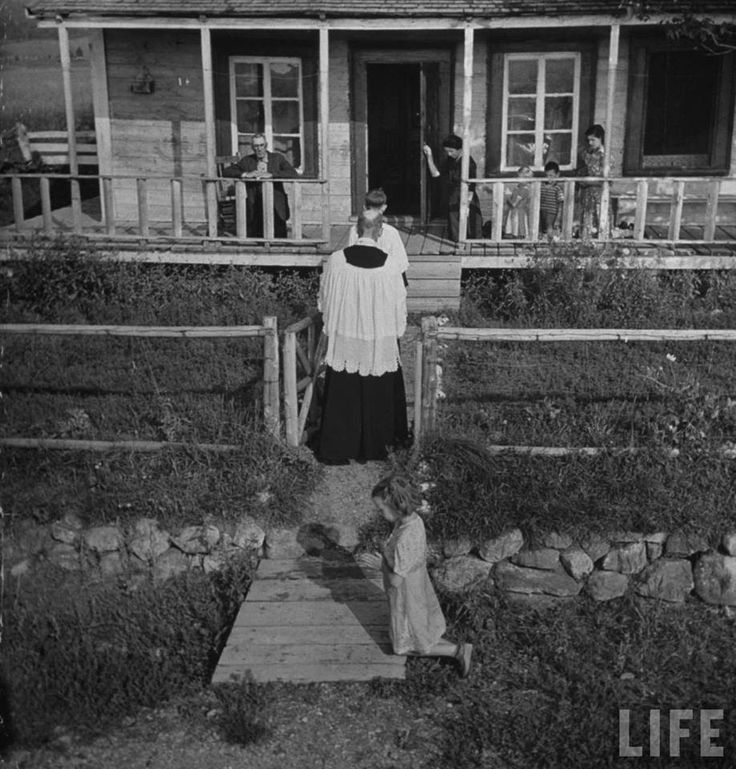 Taking Holy Communion to the sick.  Quebec, Canada, 1942.  Notice the reverence.  We need to get back there..........this picture is sooooo beautiful.  It takes my breath away.