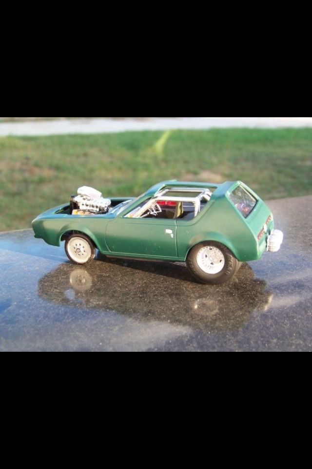 Grumpy's Model cars. I am a dying breed of Plastic Model car builders. AMC gremlin, Ford Mustang, and a ton of scratch building made this bashed build.