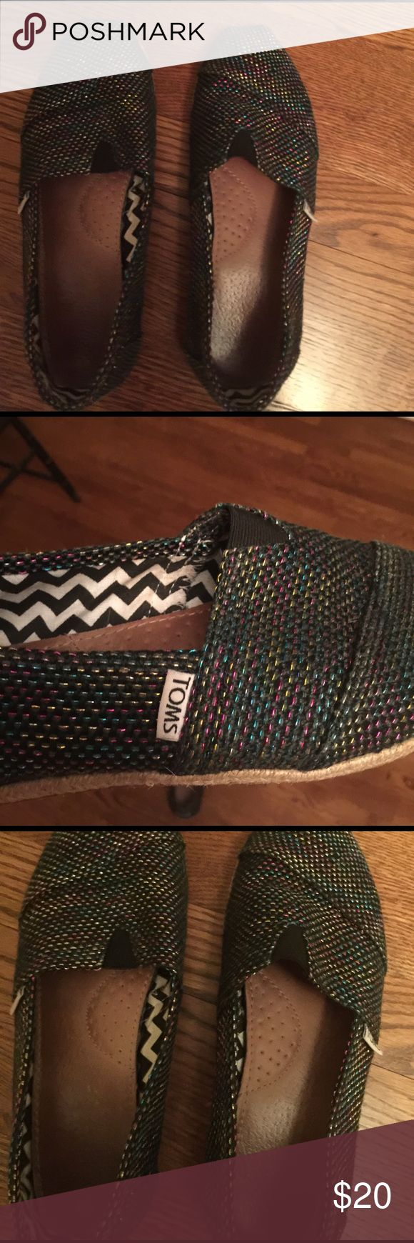 Black burlap toms with multicolored thread This is a preowned pair of toms sz 9 black burlap with multicolored metallic thread throughout. These are in great preowned condition. TOMS Shoes Espadrilles