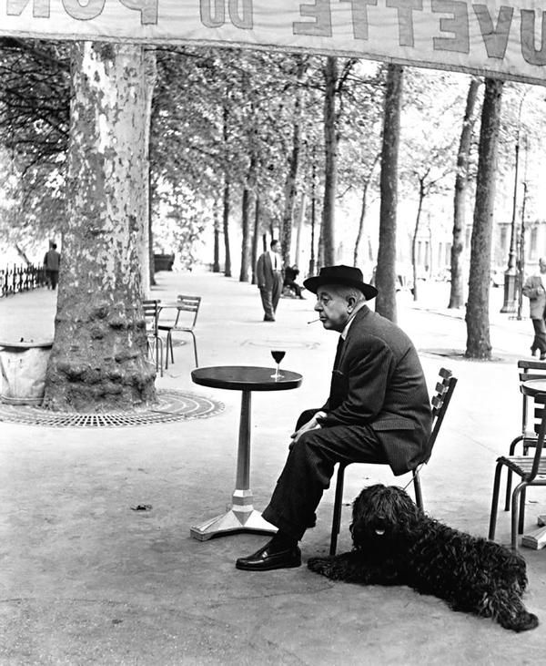 photograph by Robert Doisneau - looks peaceful : the man, his glass of wine and his dog (http://www.highendweekly.com)