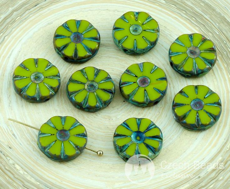 Color: Picasso / Opaque Olive Green Size (mm): 12mm Hole size (mm): 1mm (approximately) Shape: Flat Carved Table Cut Flower Beads / Round Coin Sold in pack