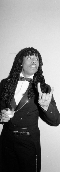 """Rick James (born James Johnson, Jr.), singer, songwriter, musician and record producer, best known for being the major popularizer of funk music. His hits include You and I, Give It to Me Baby, Super Freak, Fire & Desire (with Teena Marie), Mary Jane, and 17. He was a part of a skit on Chappelle's Show called """"Charlie Murphy's True Hollywood Stories"""" where he, along with Charlie Murphy recounted humorous stories of their experiences together. """"Cocaine is a hell of a drug."""" R.I.P."""