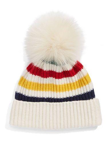 """<ul> <li>Ribbed hat styled with iconic stripes and fox fur pom pom</li> <li>Cuffed hem, about 3""""</li> <li>50% wool/50% acrylic</li> <li>Fur type: dyed fox fur</li> <li>Fur origin: China</li> <li>Dry clean</li> <li>Imported</li> </ul>"""