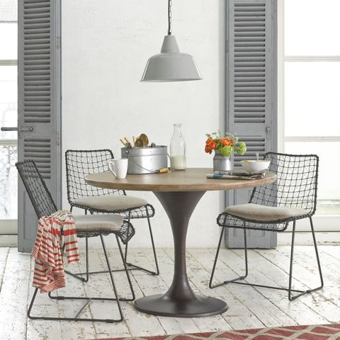 Round tulip table in a rustic setting
