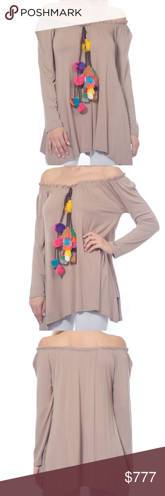 PLAYFUL and fun tunic top! Brand new no tags  Boutique item  Price is firm  Playful taupe tunic top with fun tassel/pom pom detail, sassy and popular off shoulder style. Comfortable and easy to slip on with leggins anf be ready for the day!   Material 95% RAYON 5% SPANDEX Sassy Boutique Tops Tunics