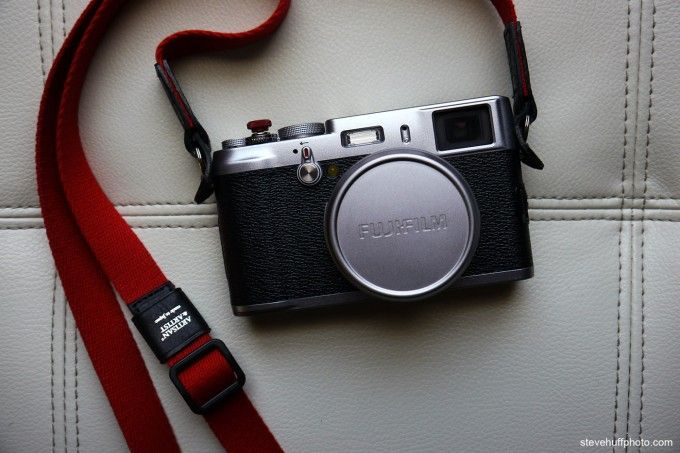 Fuji X100. Not mine, but I have the same red strap & a red soft release so it looks just like mine!