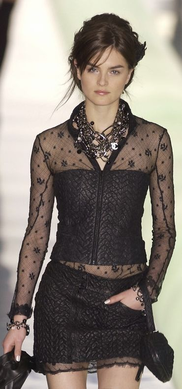 Chanel: sheer, black, with a chunky statement necklace.  Ready for a night out in Paris!
