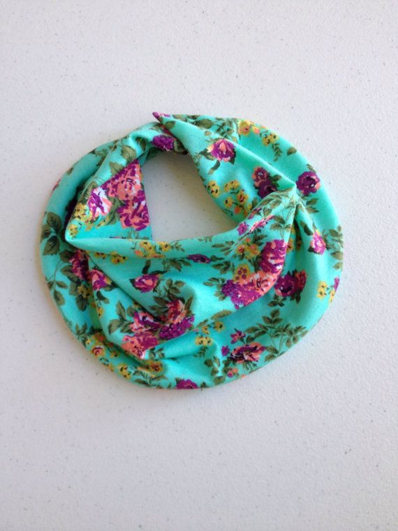 This baby drooler scarf is super soft jersey knit fabric. Perfect for your little drooler! It snaps in the back, and gathers in the front like a scarf!