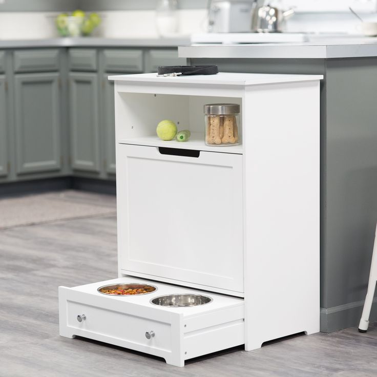 A gift you and your pet will love. This feeder station holds up to 33 pounds of food and keeps pet accessories organized. It features a pull-out tray with inset stainless steel food and water bowls