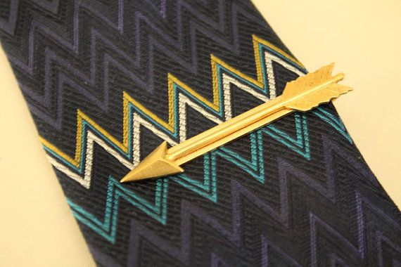 {Gold Arrow Tie Bar by iadornu on Etsy | $35} a fun tie bar to compliment the weddings gold accents.