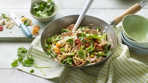 Peanut butter and coconut milk make a quick DIY satay sauce. Pack out this filling noodle dish with plenty of fresh veg and strips of chicken or turkey.