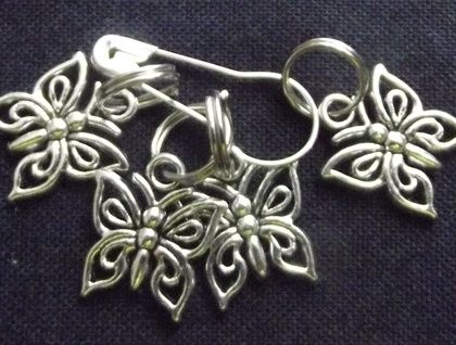 4 silver tone butterfly shaped stitch markers