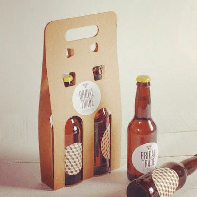 Original cardboard carrier for beer bottles with a handle to carry them easily…