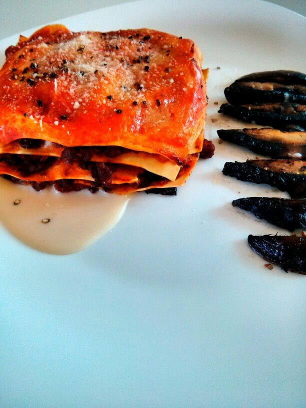 Lasagna from portobello mushrooms and béchamel flavored with parmesan.