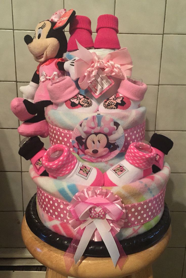Minnie Mouse inspired diaper cake includes: 3 blankets  50 diapers  4 pairs of booties  1 pacifier  1 headband  1 Minnie Mouse plush