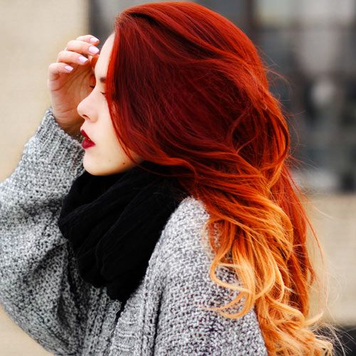 This stunning red ombre hair is gorgeous and fiery.