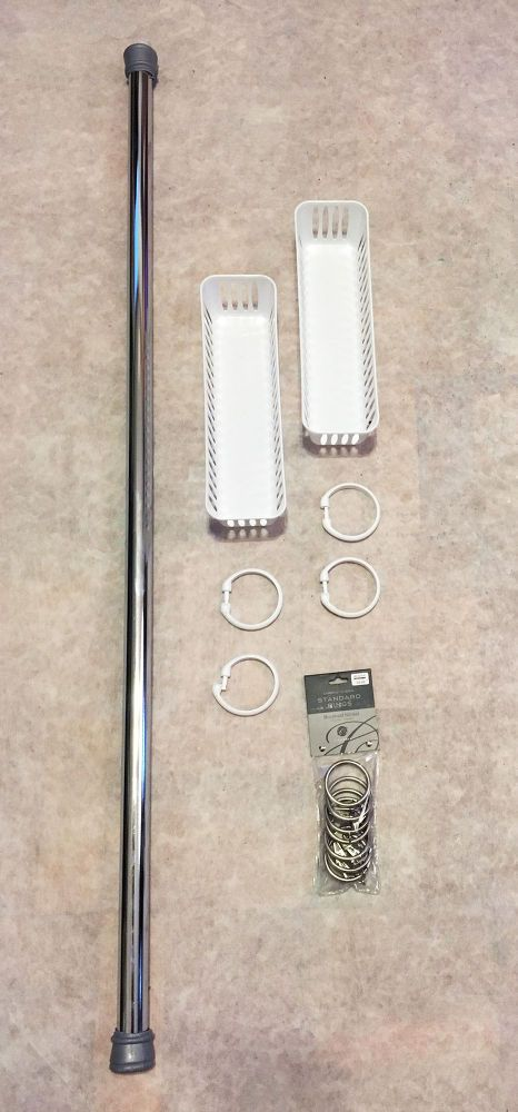 Tension+Rod+Shower+Storage - GREAT IDEA! Place shower curtain rings on an extra shower rod (tension or other) to store items in shower or elsewhere . She adds rings to openings in small rubber baskets for razor blades. She also uses curtain rings w clips to hang  her flat end tube items, rope sponges, and cloths.
