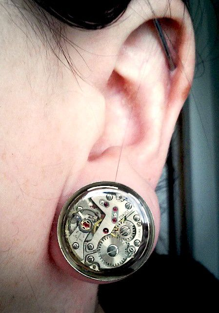 Unusual mechanics in this Gears In Your Ears steampunk plug, worn by Jamlincrow customer Christin.