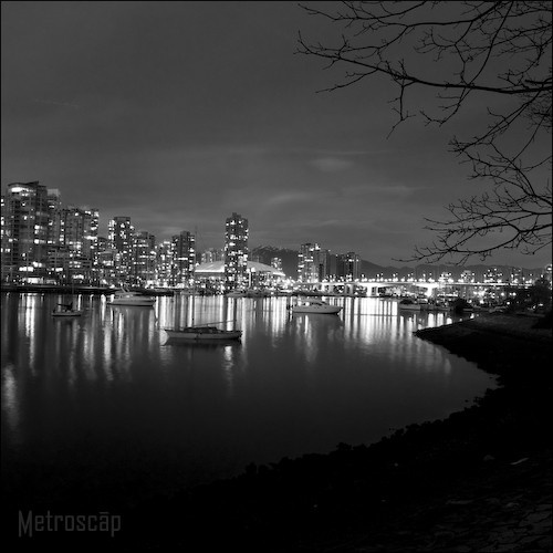 Black and white picture of Vancouver Skyline at night over False Creek.