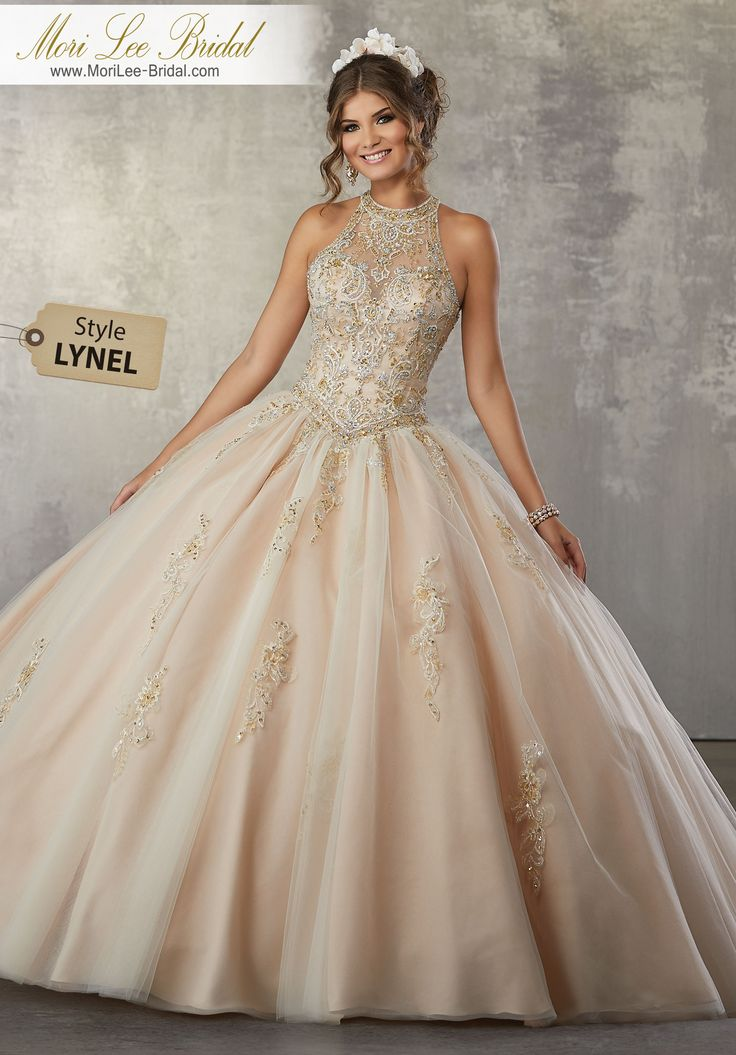 Style LYNEL Metallic, Embroidered Appliqués with Crystal Beading on a Tulle Ballgown Beautiful Quinceañera Ballgown featuring a Fully Beaded High Neck Bodice with Double Strap Keyhole Back. Matching Bolero Jacket included. Colors available: Champagne/Nude, Black Cherry, White