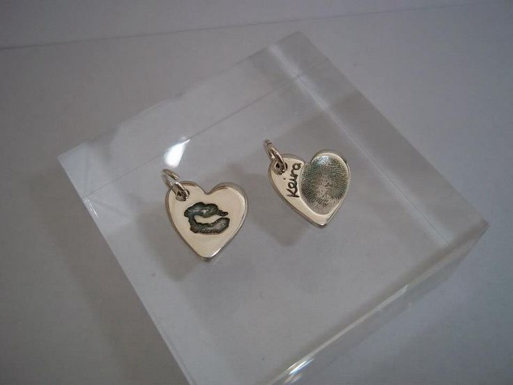 Lip and fingerprint charms with an antique finish. Small silver hearts