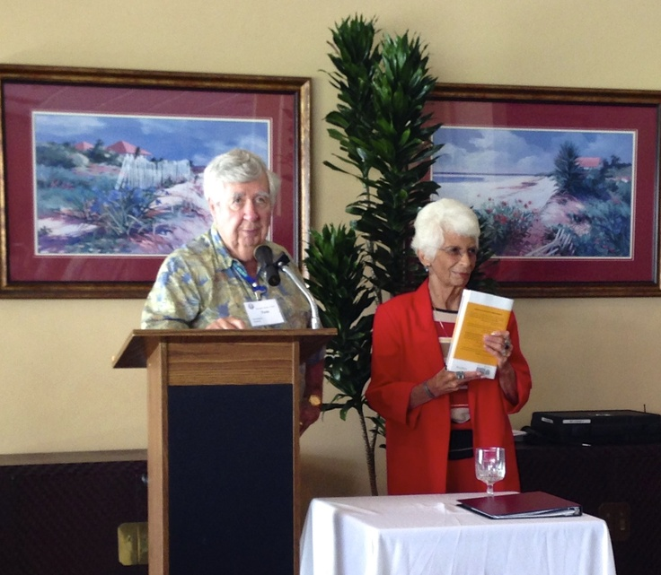 """Florida Sister Cities State Conference co-chair and former Sarasota Sister Cities president Tom Halbert, presents keynote speaker  Lou Ann Palmer a copy of David Houle's book on """"Entering the Shift Age"""" during the Friday luncheon program"""