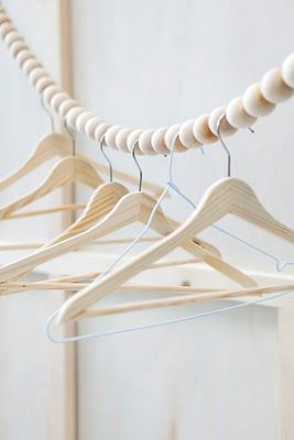makeshift closet....use the wooden balls threaded on line to separate the hangers and individual clothing items