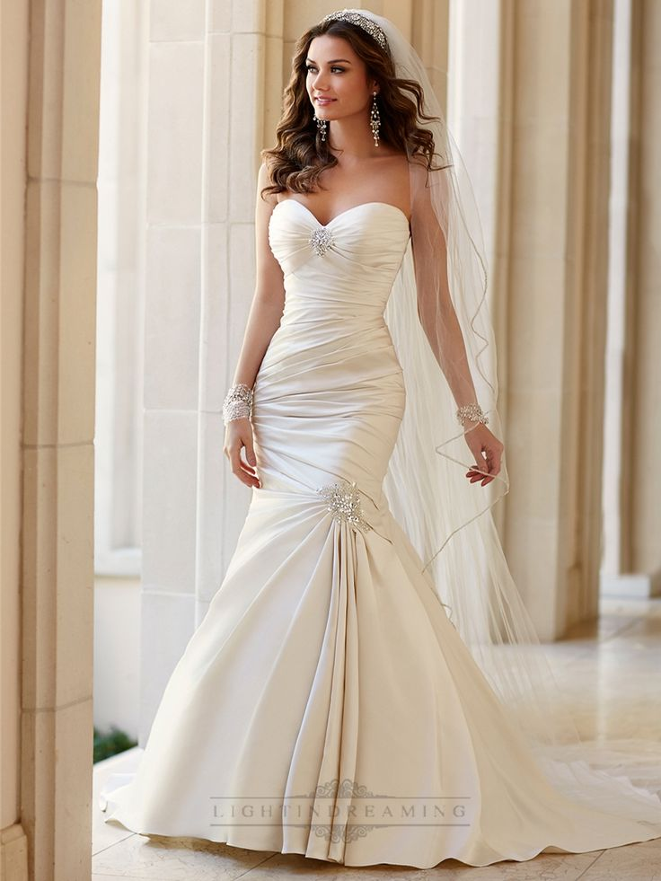 Another gorgeous dress with the embellishment on the lower part to bring the dress together