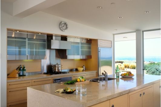 Gorgeous contemporary home kitchen with creative glass cabinets