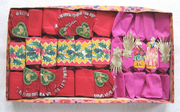 Box of eleven vintage Christmas crackers two kinds including Speedway Crackers
