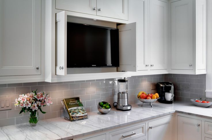 Hidden TV in kitchen cabinet--my brother suggested this for an empty space in our cabinets today; I'm falling in love with the idea.