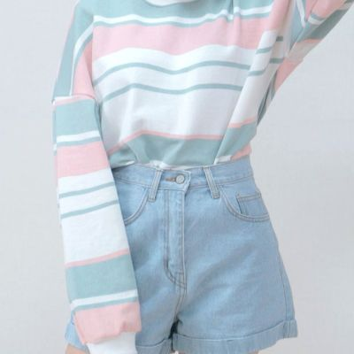 Pastel coloured outfit with high-waisted, baby blue shorts.