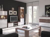 Meble białe z elementami w kolorze naturalnego drewna doskonale komponują się w salonie w nowoczesnym stylu. Są propozycją dla zwolenników nowoczesnych wnętrz, którzy nie boją się ciekawych rozwiązań.