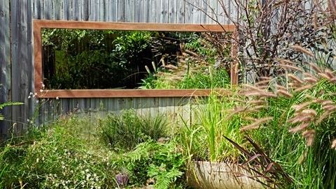 Use a mirror to create the illusion of space in your outdoor area. Simply take an old mirrored door and frame it in durable spotted gum. Once it's hung, your yard will go from tiny to titanic!