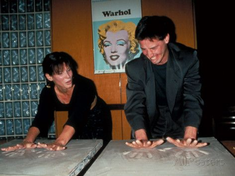 Sandra Bullock and Keanu ♡♥ Reeves Making Imprints of Hands in Cement Slabs at Planet Hollywood Premium Photographic Print at AllPosters.com