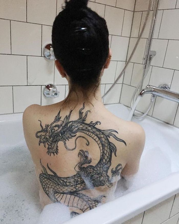 Woman In Bathtub Large Japanese Dragon Tattoo Black Hair In Messy Bun In 2020 Dragon Thigh Tattoo Back Piece Tattoo Dragon Sleeve Tattoos