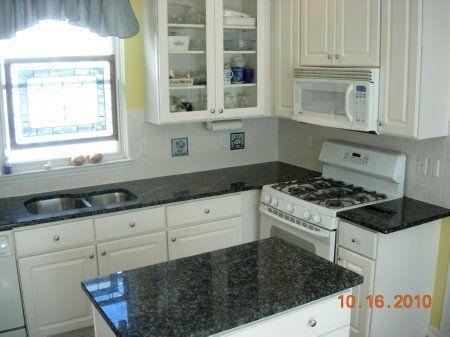 White kitchen cabinets gray granite countertops google for White kitchen cabinets with blue pearl granite