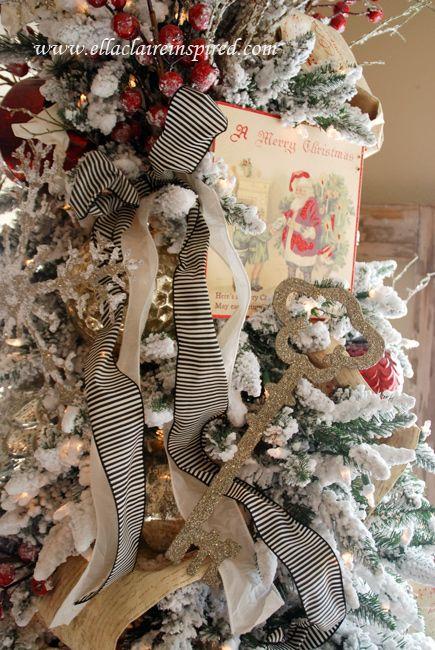 {Ella Claire}: Flocked Christmas tree. Love that black & white ribbon