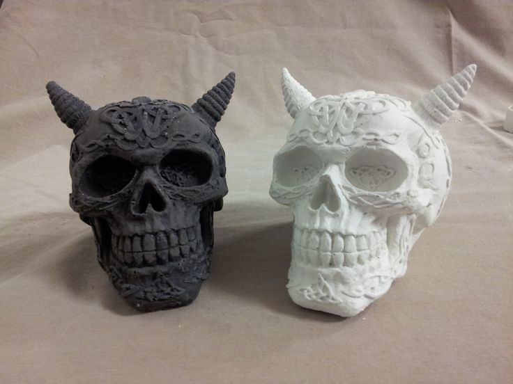 Concrete Skulls one with black concrete dye and the other casted in white concrete
