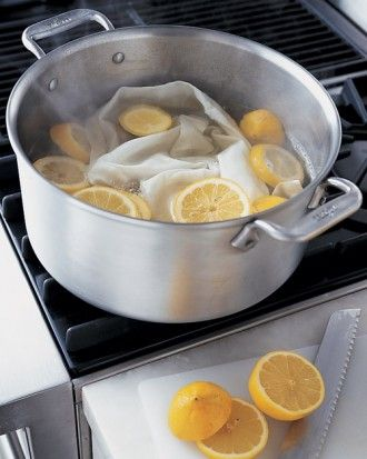 How to whiten socks: Fill a pot with water and a few slices of fresh lemon; bring the water to a boil. Turn off heat, add linens, and let soak for up to an hour; launder as usual. For extra brightening, spread them out in the sunlight to dry.