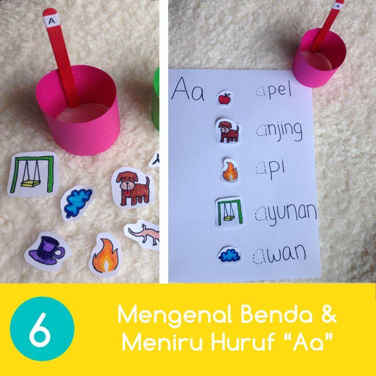 Mengenal Benda & Meniru Bentuk Huruf 1. Setelah anak berhasil mengelompokkan benda ke dalam keranjang (aktivitas 5), ajak anak untuk mengenal nama-nama bendanya dalam bentuk tulisan. 2. Anda bisa menuliskan nama-nama benda itu di selembar kertas putih dan minta Anak untuk mencocokkan gambar dengan tulisan. 3. Lalu, Anda bisa meminta anak untuk menebali bentuk huruf depan dari masing-masing benda sambil mengenalkan huruf tersebut kepada Anak.