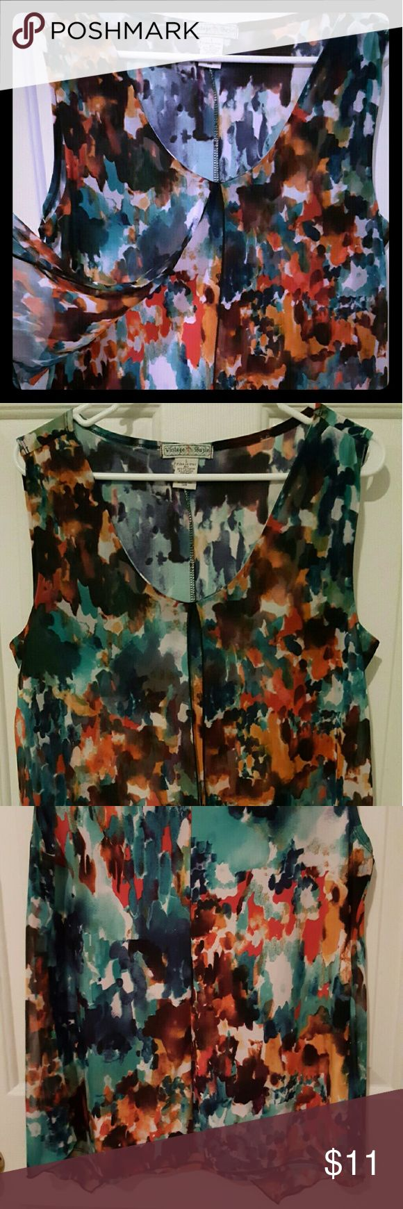 Summertime Fun Top Multi-colored flowy top that is great for humid summer nights. 100% polyester flowy sheer covering, 96% & 5% spandex top. Gently worn. Newly laundered.  Measurements: 18 in bust (armpit to armpit) 25 in long (shoulder to bottom) Vintage Suzie Tops Blouses