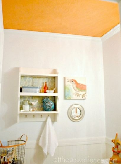 Paint a pop of color on the ceiling and then use that color as an accent color around the room!