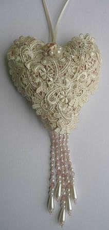 Idea for pincushion - love the beaded dangles! :)