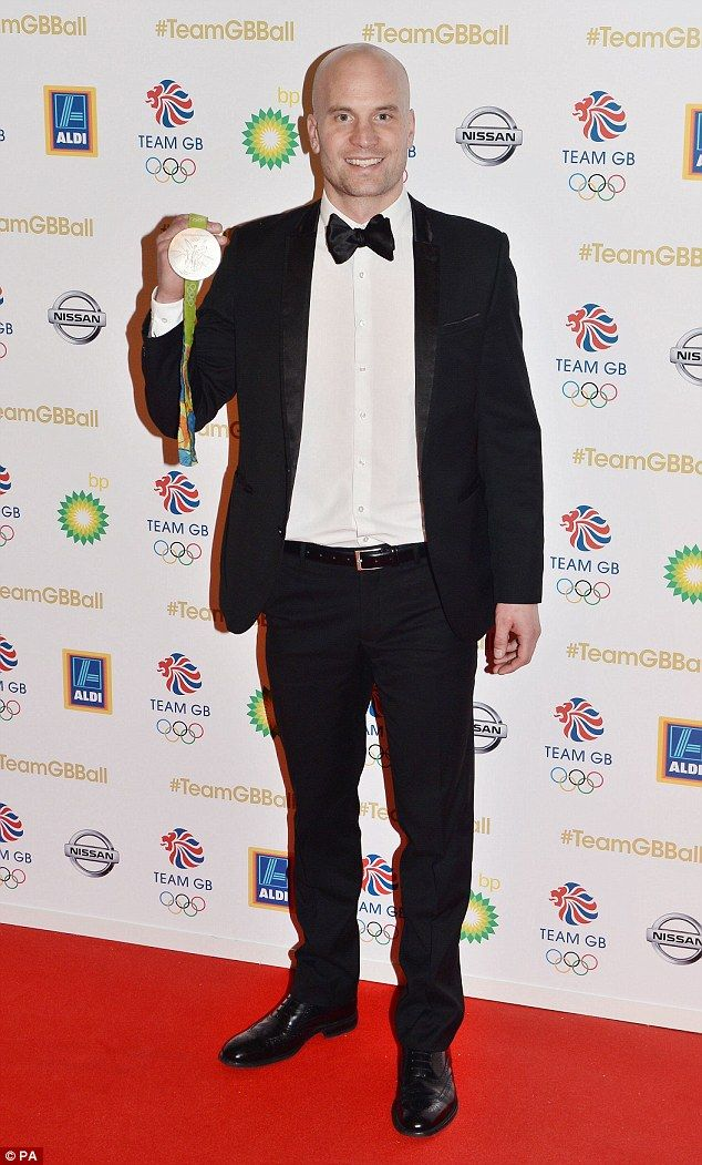 Gold star! Richard Hounslow showed off his gold medal as he arrived at the bash