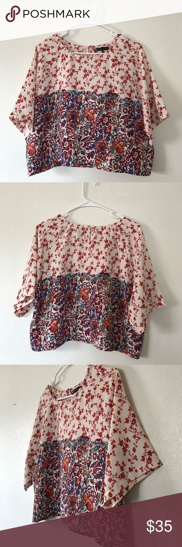 """House Of Harlow 1960 Short Flower Blouse Retro Super cute retro style short Blouse by House Of Harlow 1960 in a size small. Blouse is in great condition with no rips, snags, or stains. This is a short style Blouse that was made to be worn with a high rising bottom (skirt/jeans) or to show your midriff. Blouse measures approximately when laid flat: 19"""" long, 21.5"""" from armpit to armpit, sleeve length is 15"""". Feel free to ask any questions! House of Harlow 1960 Tops Blouses"""