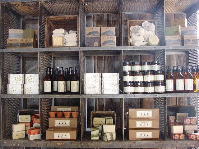 Separate compartments to display bath and body products at a craft show.