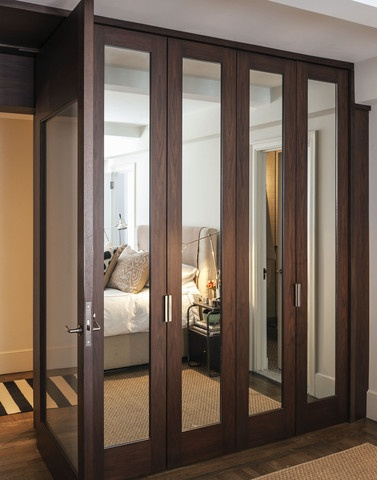 custom mirrored closet doors - but in white. wider at the bottom than the sides.
