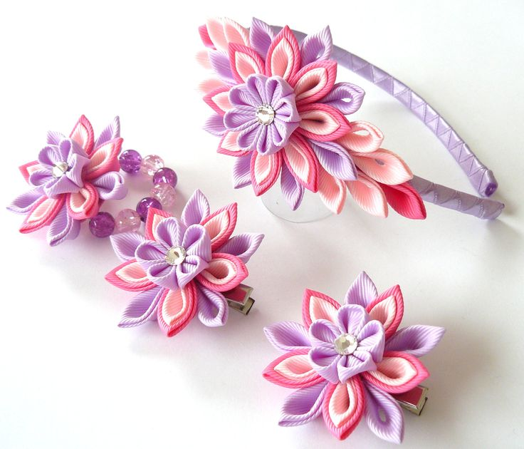 Kanzashi fabric flowers. Set of 4 pieces.  Hot pink, lt. pink and orchid via Etsy.